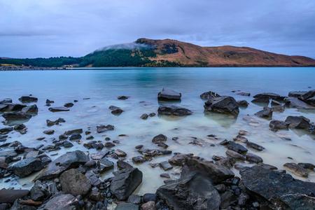 Lake Tekapo, South Island, New Zealand. Shot at long exposure to soften the water.