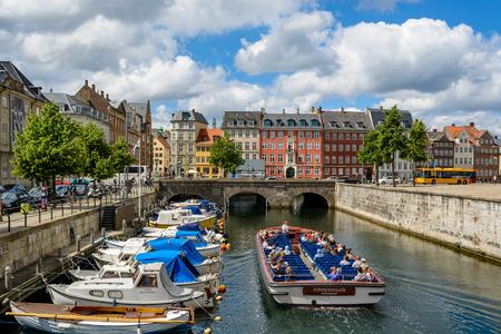 COPENHAGEN, DENMARK - June 26, 2016: Tourists are cruising Copenhagen through one of its typical water canals Redakční