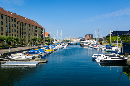 COPENHAGEN, DENMARK - June 23, 2016: Water canal in Copenhagen on a sunny day with plenty of parked boats