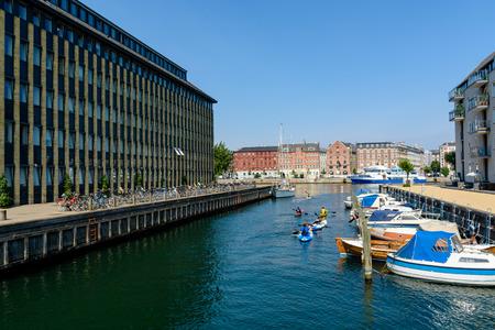 COPENHAGEN, DENMARK - June 23, 2016:  Children are kayaking in a water canal in Copenhagen, Denmark Redakční