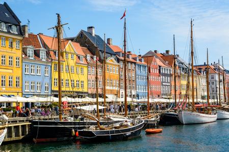 COPENHAGEN, DENMARK - June 23, 2016: People are walking along Nyhavn area in Copenhagen Redakční