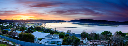 A ultra wide panorama of Knysna lagoon at sunrise, South Africa
