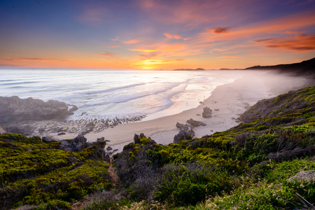 Long exposure of a colourful sunset over Brenton-on-sea main beach in South Africa Reklamní fotografie