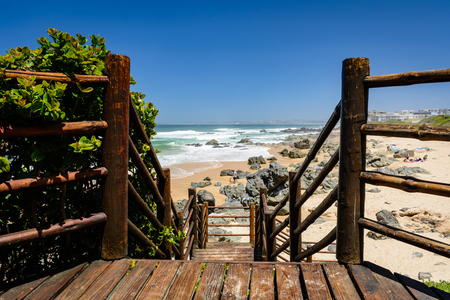 Wooden boardwalk leading to the beach in Keurboomstrand, South Africa