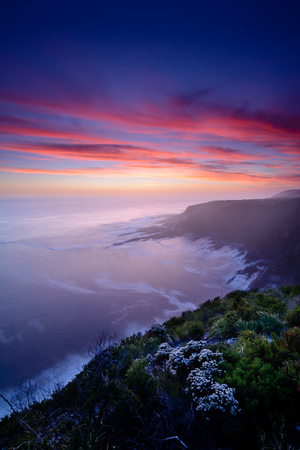 Dreamy, dramatic and colourful sunset over Storms River Mouth national park, South Africa. Long exposure with blurred water Reklamní fotografie