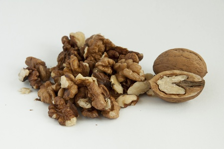 Walnuts on white background, one entire and others separated Stock Photo - 9732904