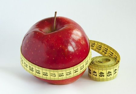 Yellow tape Measure with red Apple Stock Photo - 9732892