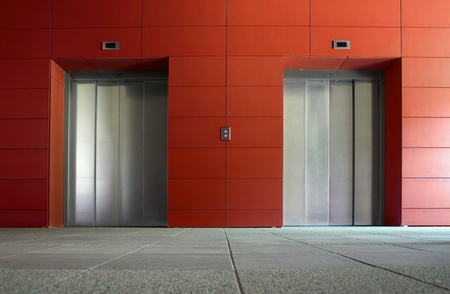 Two elevator doors in a luxurious building Stock Photo - 9780156