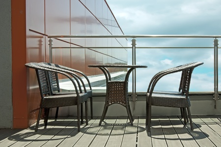 Table with two chairs on terrace Stock Photo - 9780075