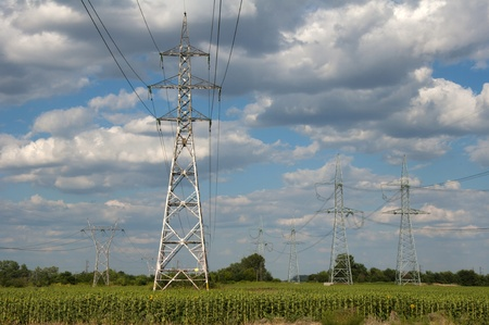 Metal electric poles on a blue sky background Stock Photo - 9819353