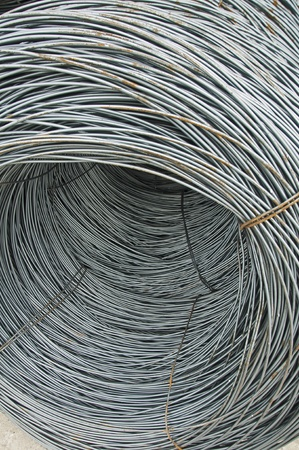 Reinforcing steel bars on roll. Construction materials photo