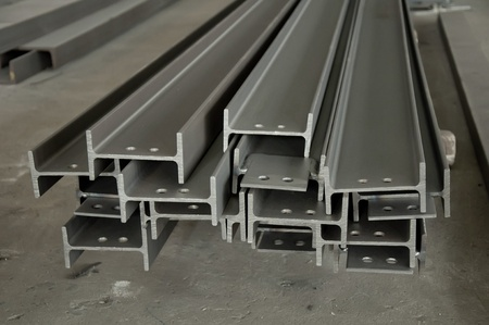 steel factory: Metal profiles stack on shelf Stock Photo