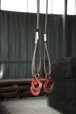 Three metal hooks with wire rope. Reinforcing steel background Stock Photo - 9819265