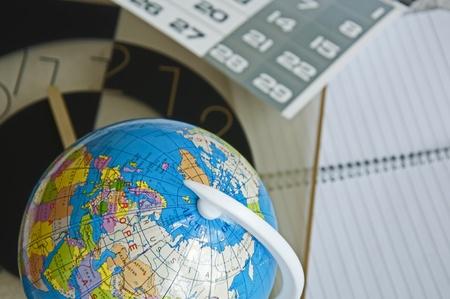 Globe business calendar calculator and notebook photo