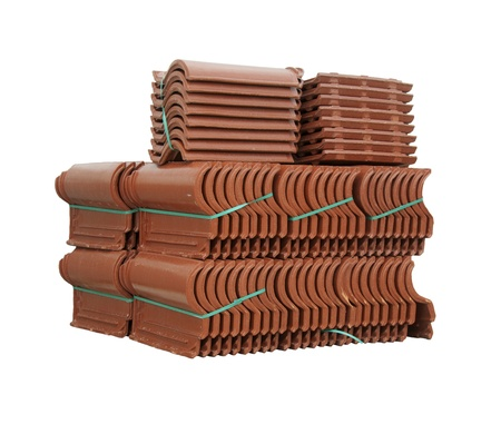 Pile of roofing tiles packaged. Isolated on white photo