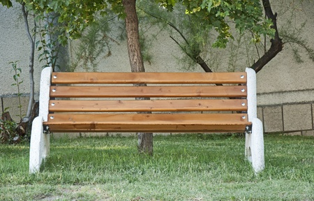Brown bench on green meadow Stock Photo - 9927485