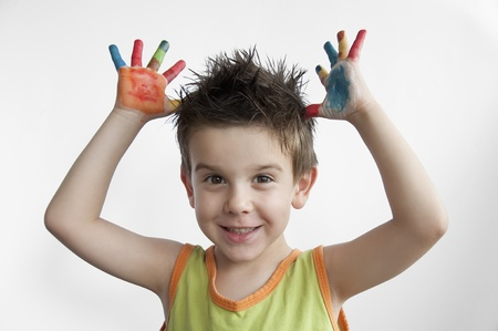 Children colored hands. Little boy hands.White isolated Stock Photo - 9927460