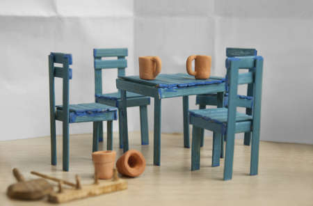 Handmade Old table and four chairs. Blue color photo