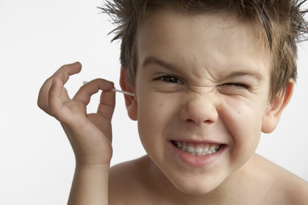 Boy cleans his ear. Isolated white background Stock Photo - 9927598