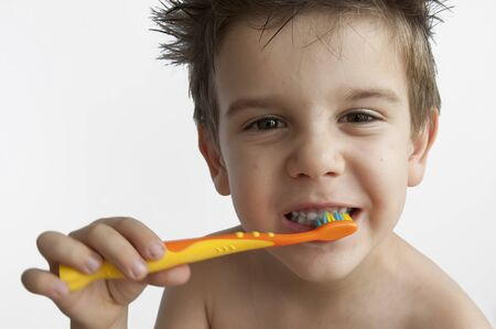 Boy washing teeth with toothbrush Stock Photo - 9927599