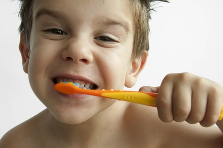 Boy washing teeth with toothbrush Stock Photo - 9927600