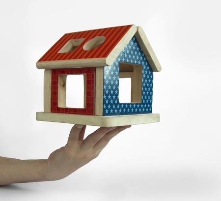 Wood colorful house toy in hand photo