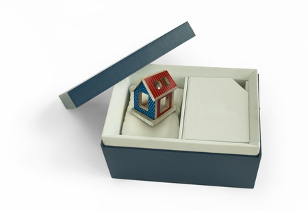 Gift box with house inside. photo