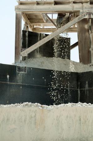 fragmentation: Machine for fragmentation of stones. Falling rocks Stock Photo