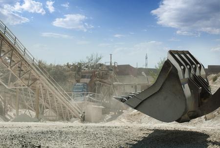 Machines for rock fragmentation and bucket of bulldozer photo