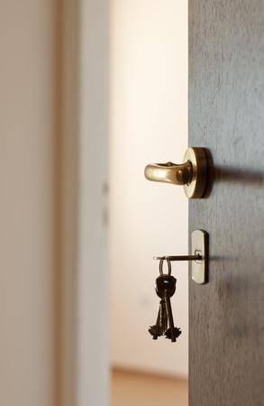 Open door with keys. Real estate