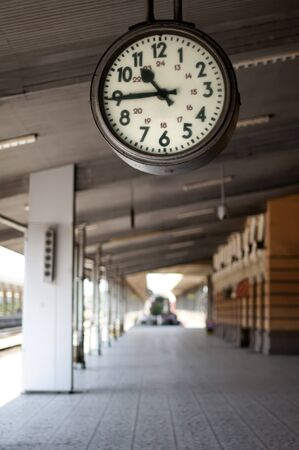 railroad station: Railway station analog clock. Vertical image