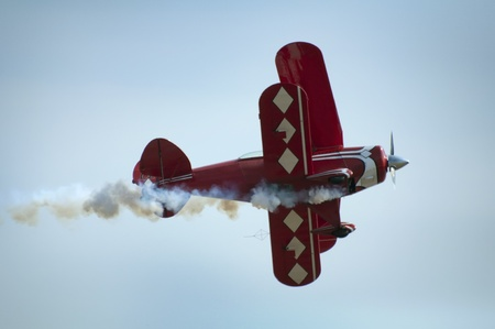 looping: Red plane looping in a blue sky. Close up Editorial