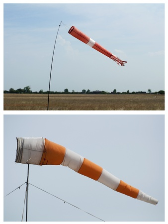 windsock: Red vane on blue sky background. Two items