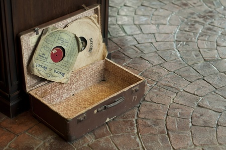 antique suitcase: Old Antique suitcase with two gramophone discs Stock Photo