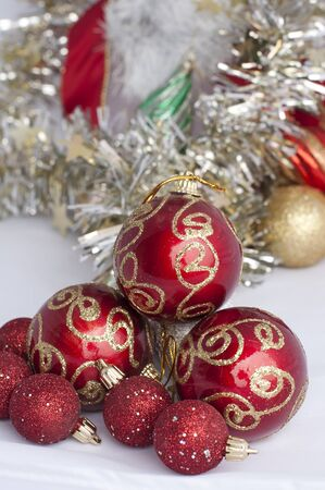 Christmas motifs with balls and chains. Red and white balls, white chains and red ribbon photo