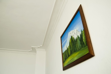 Oil painting on white wall.  photo