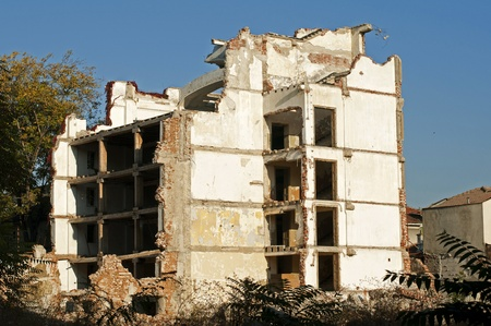 Old demolished building. White walls. Exterior