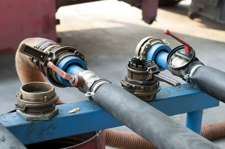 Big Truck Hoses for fuel station, pumps and oil barrels photo