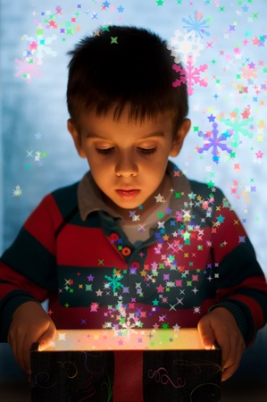 scintillating: Child peeping in a gift fancy box Stock Photo