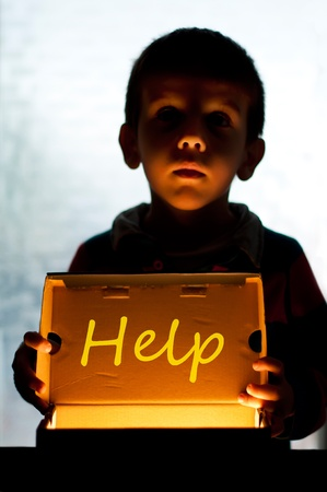 poverty relief: Child and box shine light. Call for help and hope. Help me