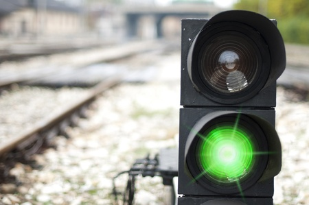 railroad track: Traffic light shows red signal on railway. Green light