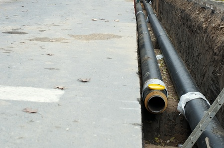 Installing pipes for hot water and steam heating. City heat pipeline