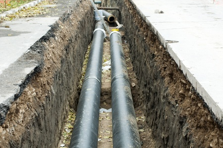 Installing pipes for hot water and steam heating. City heat pipeline Editorial
