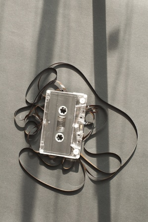 Audio tape cassette with subtracted out tape. Old broken cassette photo
