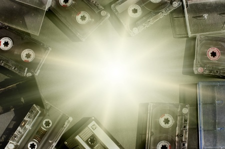 Old fashioned audio tape cassettes background. Text space in center photo