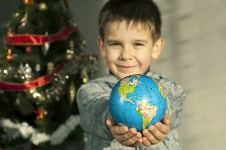 Child who give as gift the world on Christmas. photo