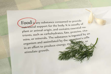 dill: Food topic. Text on paper and garlic and dill