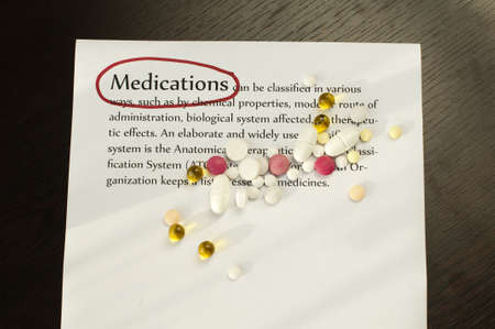 Drugs on the score sheet with text medications photo