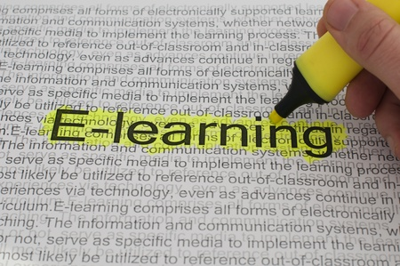 Typed text E-learning on paper and texts on background. Yellow marked photo