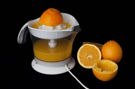 White citrus Juicer and oranges. Black background Stock Photo - 11690259